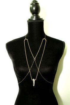 Elegant body harness featuring vintage chains and ornate findings of solid brass as well as a rough crystal quartz pendant. Handmade from quality