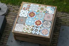 Nice idea for a small DIY garden table. I'd like to do this using Moroccan t… Nice idea for a small DIY garden table. I'd like to do this using Moroccan tiles with colorful patterns. Table Jardin Palettes, Garden Furniture, Diy Furniture, Arte Pallet, Diy Garden Table, Tiled Coffee Table, Tile Tables, Moroccan Tiles, Woodworking Projects Plans