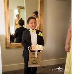 Cute ring bearer with a  Customised ring box and hessian sign supplied by Love Theory.  Email lovetheoryza@gmail.com to order or for more info.