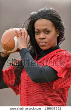 stock-photo-attractive-young-african-american-woman-in-red-practice-mesh-jersey-holding-a-generic-american-138936392.jpg (300×470)