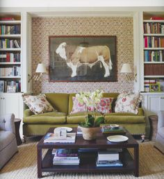 Love the scissor telescoping lamps and the wallpapered/upholstered alcove.
