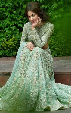 This designer lehenga is featured in mint green color gorgette with hand embroidered zardozi work. Embroidery is in dabka, diamontale and silk threads. This des
