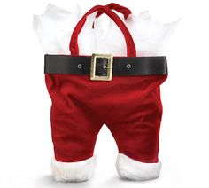 This bag holds two bottles of wine in Santa's pants. Ok, it doesn't have to be wine but wine not? Santa's pants velveteen fabric Tote Bags are a must for every