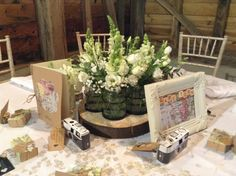 Table Centre - Ring of Jar on wooden slice containing all white Lisianthus, Antirrhinums, Gyp and Foliage #TableCentre #Wedding Flowers #White