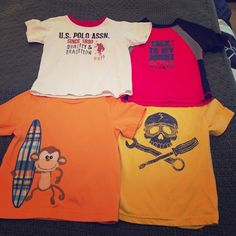 24M t shirts Red one sold. All worn, but in good condition. The monkey has a pen stain, as pictured, and the skull has a seam falling out at the bottom (also pictured). These are accounted for in the price. Tops