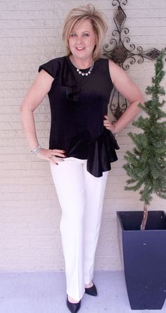 Black and white is always a hit, interesting top with ruffles.