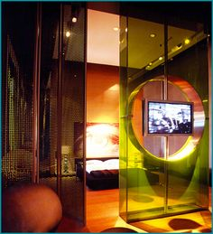 Architect Brunete Fraccaroli wanted the space to be functional, but also trendy, so she utilized laminated glass for both its eye catching beauty and practicality in dividing a space.