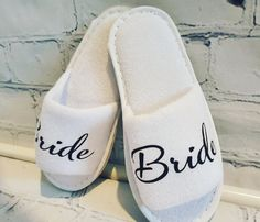 Personalosed spa slippers perfect for morning of the wedding, hen party, girls night in, bridal party present or as a little gift! Select from either name, initials or title Please allow up to weeks for delivery! Bridal Party Presents, Spa Slippers, Little Gifts, Girls Night, Slip On, Trending Outfits, Lady, Unique Jewelry, Sneakers