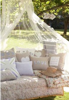 front porch shabby chic wicker furniture and floral accent pillows. lovely