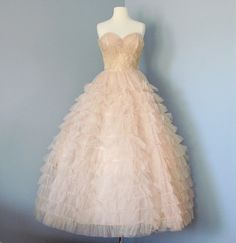 1950s Prom Dress...Mint Condition Pale Pink Tulle Will Steinman Original Strapless Prom Dress Wedding Dress. $245.00, via Etsy.