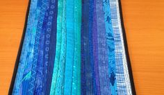 "Sky blue table runner. Quilted runner. Table topper. 12 x 40"". For the home. Modern quilt. Blue table runner. Landscape art. Gift for Mother by AnnBrauer on Etsy https://www.etsy.com/listing/228911531/sky-blue-table-runner-quilted-runner"