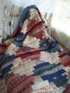 red, cream, and blue quilt.