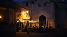 Historic centre at night. Alghero, Sardinia Italy, Street Lamp, Mediterranean Sea, Italy Travel, Dusk, Great Places, Travel Guide, Centre