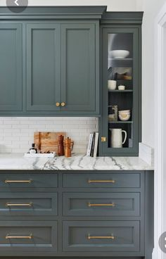 We Want These Green Kitchen Cabinets Stat If there is anyone who can predict trends, or make trends happen, it's Emily Henderson. Here the designer proves it again with a gorgeous green kitchen. Green Kitchen Cabinets, Kitchen Cabinet Colors, Kitchen Redo, Home Decor Kitchen, Home Kitchens, Kitchen Dining, Kitchen Remodel, Kitchen Ideas, Kitchen Colors