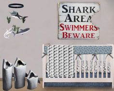 Shark baby nursery theme decorating ideas for a boy for shark week and beyond! DIY shark nursery decor tutorials that you can make yourself. Shark baby blanket tutorial and shower gift ideas to make.