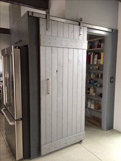 Sliding barn door | unfinished door was sealed, stained and painted metallic silver