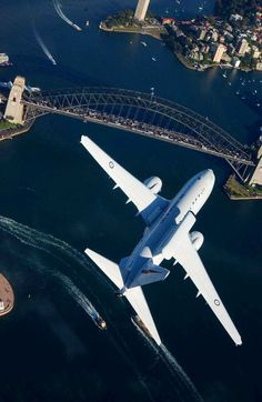 A RAAF Boeing 737 Wedgetail AWACS (Airborne Early Warning and Control) Aircraft flying over Sydney Harbour Bridge Australian Defence Force, Royal Australian Air Force, New Aircraft, Military Aircraft, Harbour Bridge, Aerial View, Airplane View, Around The Worlds, Journey