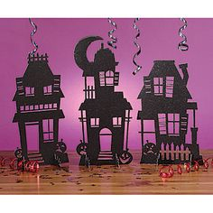 Our Haunted House Glitter Centpieces have three different glittery black houses that will surely give anyone the creeps. Each glitter haunted house centerpiece is made of paper.