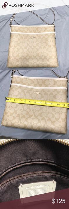 906ce392bbde Tan Signature Coated Canvas with Cream trim. fabric lining. Zip-top closure  with outside open pocket