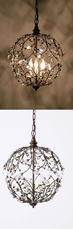 Lambent Sphere Chandelier - Anthropologie - Intricate wrought iron stems twist and twine, punctuated by glimmering crystal leaves that enclose three flickers of light.