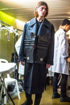 Black leather jacket look at Margiela AW14. More images here: http://www.dazeddigital.com/fashion/article/18487/1/maison-martin-margiela-aw14