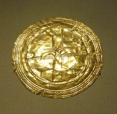 Irish National Museum of Archaeology: Gold Disc from the Irish Bronze Age      The Irish National Museum of Archaeology, Dublin. A wonderful museum: you are allowed to take photographs. Unlike the British Museum, where you also are allowed to take photographs, it is not so crowded, so you can actaully get close enough to the collections to take the photos! Has a superb prehistoric collection. and its free!