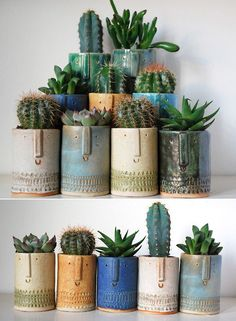 This could be achieved with copper pipe cut at different levels, buried in the ground and succulents planted in the tops.