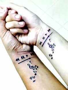 Matching music themed best friends wrist tattoos.