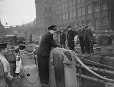 Lieut Cdr Norman, C.O. of HMS GRAPH on the bridge as she comes alongside in the Clyde during trials in February '42. She was a German Type VIIC U-boat which was captured and used by the British Royal Navy during World War II. Commissioned as the U-570 in mid-1941, she was attacked and captured on her first patrol.She carried out three combat patrols.