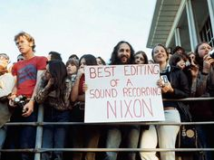 A spectator holds up a sign at the Academy Awards, April 1974 - - Imgur