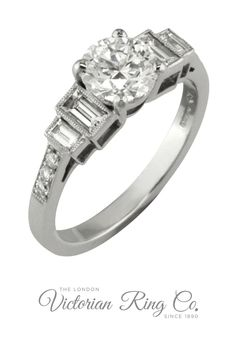 This Art Deco style engagement ring features both baguette and round diamonds on a platinum band.  A four-claw setting holds the central GIA graded round brilliant cut diamond.The two baguette cut diamonds are held in a rub over rectangular shape setting, which has then been expertly edged with tiny platinum grains referred to as millegrain. The baguettes lead to three round diamonds that echo the shape of the large central diamond. #diamondrings #diamondengagementrings #baguettediamonds Baguette Engagement Ring, Baguette Diamond Rings, Deco Engagement Ring, Diamond Engagement Rings, Jewelry Insurance, Art Deco Jewelry, Diamond Gemstone, Unique Rings, Wedding Things