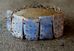 nail holes in copper, transparent water blue enamel fired and sanded-bracelet