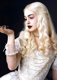 White Queen: Anne Hathaway says: 'I wanted her to have the punk spirit of Debbie Harry, the etherealness of American artists Dan Flavin and the grace of Greta Garbo.'   Read more: http://www.dailymail.co.uk/tvshowbiz/article-1252091/Alices-weird-wonderland-Why-scenes-row-Tim-Burtons-fantastical-film-disappear-cinemas-fast-Cheshire-Cat.html#ixzz3omzeE23r  Follow us: @MailOnline on Twitter | DailyMail on Facebook