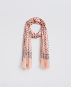 """Cast in a fresh feminine palette, our captivating medallion print scarf is destined to become your newest wardrobe staple. Light fringe at ends. 44"""" x 76""""."""