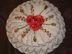 Decorative cushion made using canadian smocking and ribbon embroidery techniques #canadian smocking #ribbon embroidery #ribbon embroidery cushions