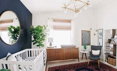 Baby Nursery Decorated With Wall Mirror And Houseplant