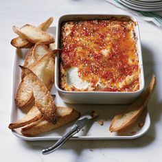 Pepper-Glazed Goat Cheese Gratin | Food & Wine                                                                    This warm, sweet-spicy goat cheese dip is an easy alternative to a cheese plate.