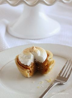 Petite sweet potato pies lightly sweetened with a ripe banana, a touch of brown sugar and spices, then topped with a light meringue topping – perfect for the Holidays!  My Mom hosts Thanksgiving every year, she wouldn't have it any other way! I usually bring a side dish and an appetizer and my cousin Nina usually brings dessert. My cousin Nina has a baking blog called Ambrosia and she often shares some of her delicious treats with us (those parker house rolls on her blog are dangerous!)…