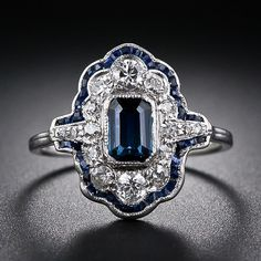 An original platinum, sapphire and diamond just-for-fun ring from the height of the Art Deco period - circa 1925. This Jazz Age delight features an emerald-cut sapphire center, framed by bright-white and sparkling European-cut and single-cut diamonds which, in turn, are outlined with a curvaceous border of tiny calibre-cut sapphires.