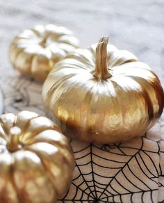 Gilded pumpkins make for one glam Halloween party idea.