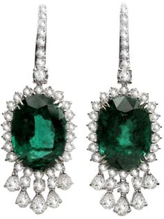 Platinum Diamond Emerald Earrings. The weight of the diamond is 9.29 carats and the weight of the emerald is 43.58 carats. Via 1stdibs.