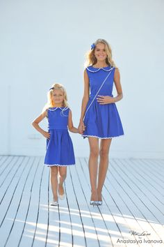Monmy and I have blonde hair, blue eyes, and blue dresses.""
