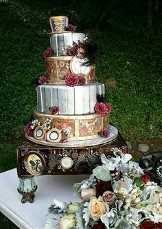 steampunk wedding cake with red flowers and a hat on top Steampunk Wedding Cake, Gothic Wedding, Rose Wedding, Wedding Favors, Wedding Decorations, Wedding Ideas, Wedding Planning, Wedding Inspiration, Simple Wedding Arch