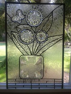 Stained Glass with Repurposed Dishes on Etsy, $287.00