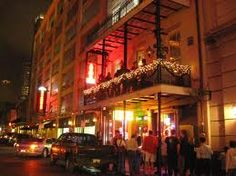 Galatoire's Restauraunt at night. 209 Bourbon in the French Quarter. Began in 1905. Closed on Mondays. No T shirts or shorts at lunch and for men a jacket after 5 and all day Sunday. An institution. $$$