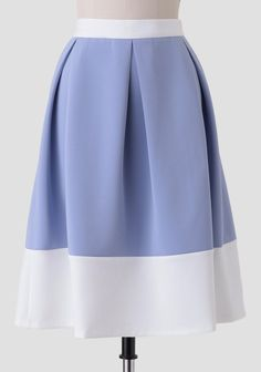 Create a variety of feminine ensembles with this charming light blue midi skirt designed with a white colorblocked pattern at the hems. Perfected with large box pleating at the waist for added ...
