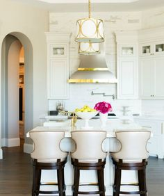 A trio of PALECEK's Rhodes Upholstered barstools spotted in a chic kitchen designed by Caitlin Wilson Design, as featured in Trad Home! http://www.palecek.com/products.php?search=rhodes&action=search&x=0&y=0