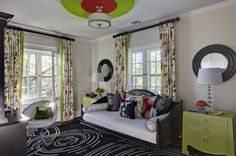 Cool, contemporary teen bedroom. Interior decoration by Barbara Feinstein, B Fein Interior Design. End tables from Bungalow 5. Custom drapery fabric from Duralee.