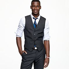 Vest and rolled up sleeves.  Suit vest in pinstripe Italian wool.