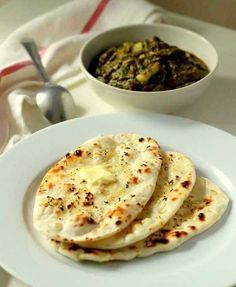 Home made soft and fluffy Indian naan bread with garlic cooked on tawa/ gas stove.